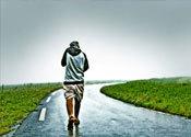 Main thumb man walking away on lonely road