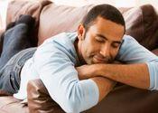 Main thumb black man sleeping on couch